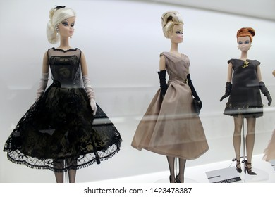 Montreal, Quebec / Canada - April 7 2019: collectible and some play dolls on the show at Barbie Expo at Les Cours Mont Royal downtown. Toys dressed in ball gowns, glamorous and fancy.