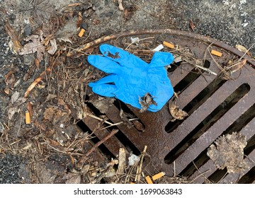 MONTREAL QUEBEC CANADA APRIL 9 2020: A discarded surgical glove is shown on a street as Coronavirus COVID-19 cases rise in Canada and around the world. photo Graham Hughes/Freelance