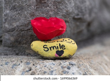 MONTREAL QUEBEC CANADA APRIL 9 2020: A small rock of support with the word Smile on it is shown as Coronavirus COVID-19 cases rise in Canada and around the world. photo Graham Hughes/Freelance