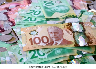 Montreal, Quebec, Canada, Dec the 16 2018 :   Many canadian dollar bills and spare change spread and filling the frame.