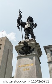Montreal, Quebec, Canada - July 10, 2018:  Statue of Paul Chomedey de Maisonneuve, founder of Montreal, atop Maisonneuve Monument in the middle of Place D'Armes in Old Montreal, vertical orientation.