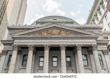 Montreal, Quebec, Canada - July 10, 2018:  Above entrance to BMO Bank of Montreal head office building as viewed from Saint Jacques Street at west end of Place D'Armes in Old Montreal.