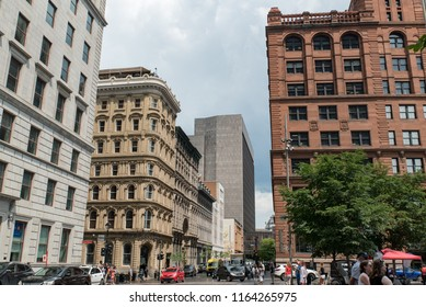 Montreal, Quebec, Canada - July 10, 2018:  Looking northeast down Saint Jacques Street from west end of Place D'Armes in Old Montreal.