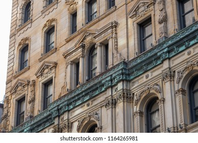 Montreal, Quebec, Canada - July 10, 2018:  Architectural details of portion of historic St. James Hotel, viewed from intersection of Saint Pierre and Saint Jacques Streets in downtown, oblique view.