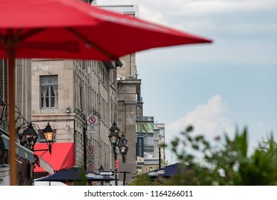 Montreal, Quebec, Canada - July 10, 2018:  Architecture looking east down Rue de la Commune East near Saint Laurent Boulevard in Old Montreal.