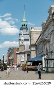 Montreal, Quebec, Canada - July 10, 2018:  Looking east down Saint Paul Street East from Bonsecours Market toward Notre-Dame-de-Bon-Secours Chapel in Old Montreal, vertical orientation.