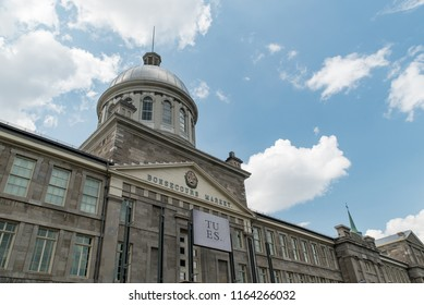 Montreal, Quebec, Canada - July 10, 2018:  Bonsecours Market as viewed from Rue de la Commune East in Old Montreal, oblique view.