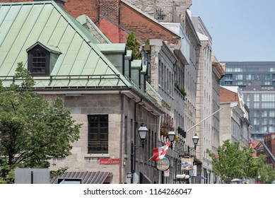 Montreal, Quebec, Canada - July 10, 2018:  Looking east at buildings along Saint Paul Street East at Jacques Cartier Square in Old Montreal.
