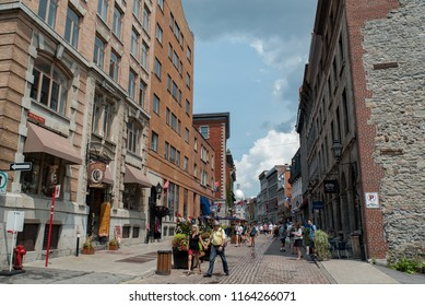 Montreal, Quebec, Canada - July 10, 2018:  Looking east down Saint Paul Street East at Saint Gabriel Street at people and buildings in Old Montreal.