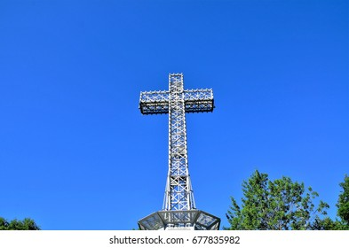 Montreal, Quebec, Canada - July 3, 2016: The Mount Royal Cross is a monument on top of Mount Royal in Montreal. It overlooks the eastern part of the island.