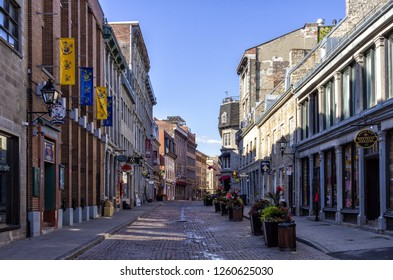 Montreal, Quebec, Canada - June 25, 2018: Looking  down Saint Paul Street East at Saint Vincent Street at buildings with restaurants in Old Montreal.
