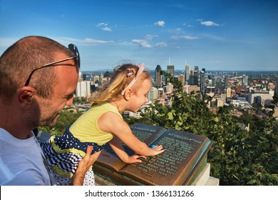 MONTREAL, QUEBEC, CANADA - JUNE 7, 2015 : Book with historical note about Jaques Quartier, discoverer of Canada, and naming the city of Montreal. Summer. View from Mount Royal.