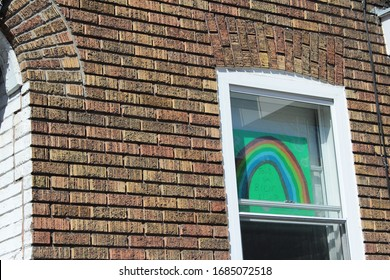 Montreal, Quebec  / Canada - March 27 2020: rainbow drawing in the window in Cote des Neiges, symbol of hope during Covid-19 outbreak and world coronavirus pneumonia pandemic, epidemy emergency.