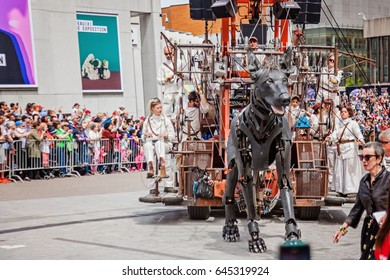 Montreal, Quebec, Canada - May 21, 2017: Place des Festivals - open-air event space. Walking dog at the Giant marionettes of the Royal de Luxe (les Geants) event for 375 anniversary of Montreal.