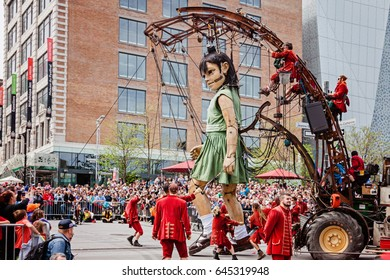Montreal, Quebec, Canada - May 21, 2017: The little girl Giant marionette and Lilliputians of the Royal de Luxe company for 375 anniversary of Montreal.