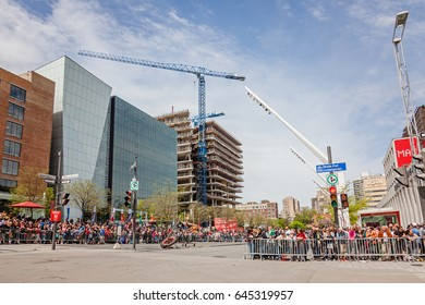 Montreal, Quebec, Canada - May 21, 2017: Place des Festivals - open-air event space. Crowd waiting for the Giant marionettes of the Royal de Luxe (les Geants) event for 375 anniversary of Montreal.