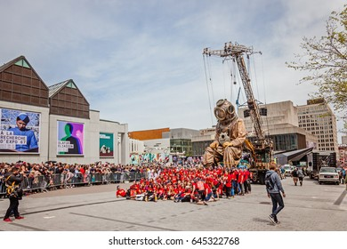 Montreal, Quebec, Canada - May 21, 2017: Place des Festivals - open-air event space. Photographer taking picture of the team 375 at the Giant marionettes event for 375 anniversary of Montreal.