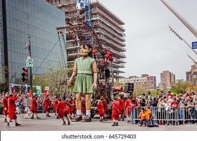 Montreal, Quebec, Canada - May 21, 2017: Place des Festivals - open-air event space. The little girl Giant marionette of the Royal de Luxe company for 375 anniversary of Montreal.
