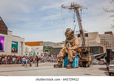 Montreal, Quebec, Canada - May 21, 2017: Place des Festivals - open-air event space. Sleeping deep-sea diver giant marionette at the event for 375 anniversary of Montreal.