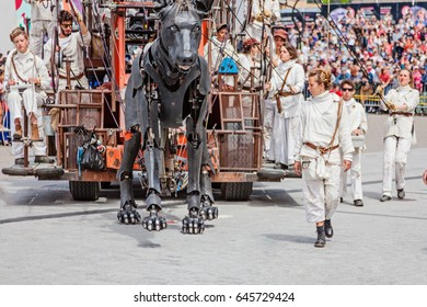 Montreal, Quebec, Canada - May 21, 2017: Place des Festivals - open-air event space. The giant dog at the Giant marionettes of the Royal de Luxe (les Geants) event for 375 anniversary of Montreal.