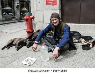 MONTREAL, QUEBEC, CANADA, MAY 24 - Homeless man with his five dogs on a street side in Montreal, Quebec, on May 24, 2013. Homelessness in the city of Montreal had grown to 30,000 people last year.