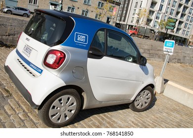 Montreal, Quebec, Canada - October 21, 2017 :  Car2Go auto sharing Smart car parked in lot on streets of Montreal, Canada on sunny day.
