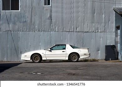 Montreal, Quebec, Canada, September 27, 2018: American Cars 1982 Used, white Pontiac Firebird Trans Am GTA, parked at the hangar