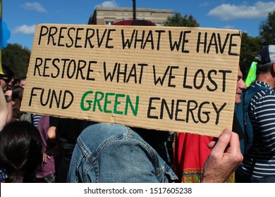 Montreal, Quebec / Canada - September 27, 2019: people manifesting for Climate Strike led by Greta Thunberg. Banner for green energy made with cardboard at the demonstration against climate change.