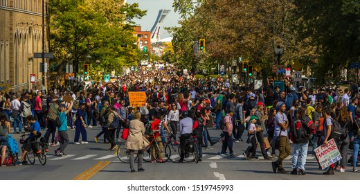 Montreal, Quebec Canada - September 27 2019: Sea of People Walking on Mont-Royal Street During March for Climate Demonstration, Friday School Strike with Olympic Stadium in Background