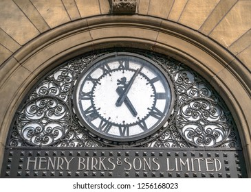 Montreal, Quebec, Canada-May 9, 2018: Henry Birk and Sons Jewelry. Metallic decorative clock above the entrance door. The place is located in the city centre which is a tourist attraction