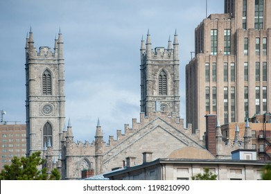 Montreal, Quebec/Canada- 05/19/2018: The spires of Notre Dame basilica can be seen from the Old Port promenade.