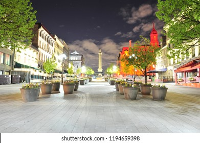 Montreal, Quebec/Canada- 06/15/2016: The Hotel de Ville is illuminated in red lighting at Place Jacques Cartier at night.