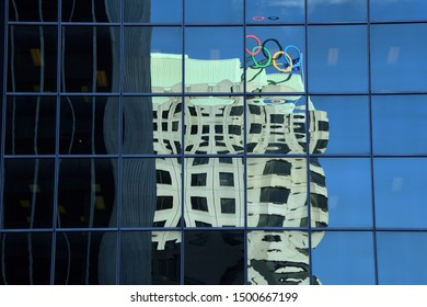 Montreal, Quebec/Canada - April 29, 2019: Olympic House reflected in modern glass facade