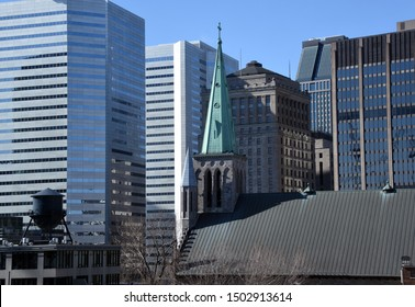 Montreal, Quebec/Canada - April 29, 2019: St. Patrick's with skyscrapers