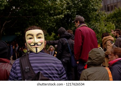 Montreal, Quebec/Canada - October 11, 2011 : Person wears Guy Fawkes mask during demonstration at Victoria square financial district, protesting corruption, corporate greed and social inequality