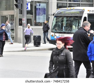 Montreal residents walk around downtown on a chilly morning. Taken on 5/17/16