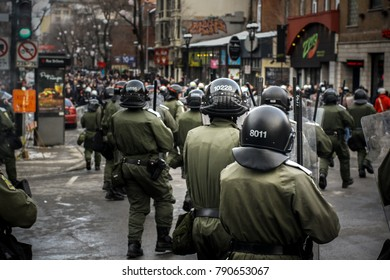 Montreal riot police against student striker