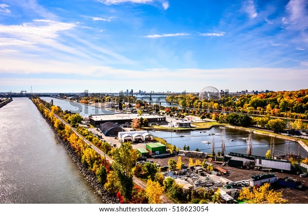 Montreal Saint Laurence river with St-Helene isle ,Maritime route,cars speed track and downtown in autumn