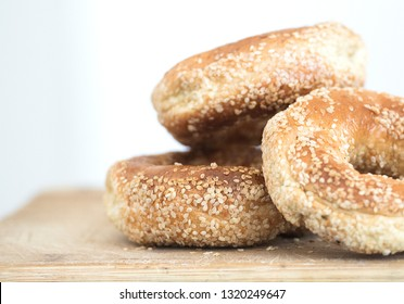 Montreal sesame seed bagels are shown on a cutting board