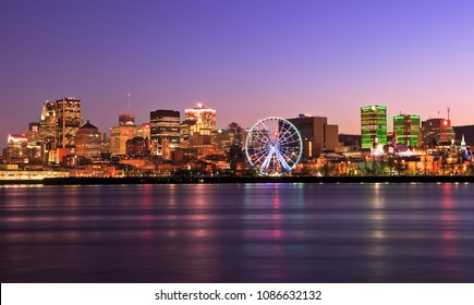 Montreal skyline at dusk and Saint Lawrence River in Quebec, Canada