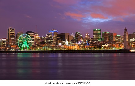 Montreal skyline illuminated at dusk and Saint Lawrence River, Canada