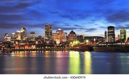 Montreal skyline and St Lawrence River at dusk, Canada