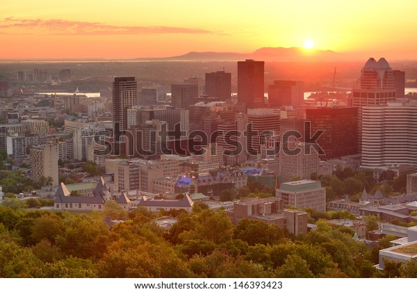 Montreal sunrise silhouette viewed from Mont Royal with city skyline in the morning