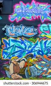 MONTREAL,CANADA AUGUST 08 2015: Street art Barney Rubble. Montreal is the perfect place to walk in the back alleys and abandoned areas, looking for street art.