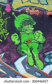 MONTREAL,CANADA AUGUST 08 2015: Street art The Great Gazoo. Montreal is the perfect place to walk in the back alleys and abandoned areas, looking for street art.