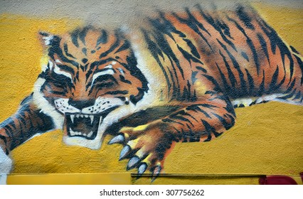 MONTREAL,CANADA AUGUST 08 2015: Street art tiger. Montreal is the perfect place to walk in the back alleys and abandoned areas, looking for street art.