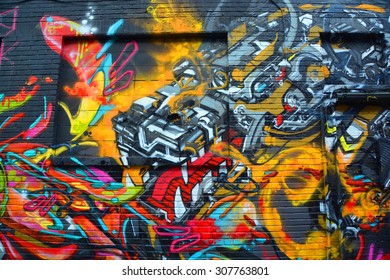 MONTREAL,CANADA AUGUST 08 2015: Street art robot. Montreal is the perfect place to walk in the back alleys and abandoned areas, looking for street art.