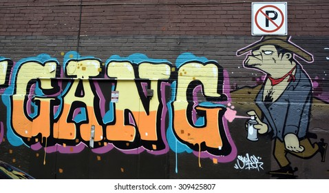 MONTREAL,CANADA AUGUST 22 2015: Street art alien Montreal is the perfect place to walk in the back alleys and abandoned areas, looking for street art.