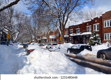 MONTREAL-CANADA DEC. 27 16: Cars cover of snow on Melrose Street. The snow storm slam Montreal with 45 cm of snow after knocking out power to thousands of homes in the U.S.