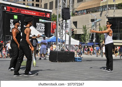 MONTREAL-CANADA JUL 08:Jugglers entertain people a the Montreal Jazz Festival on 2012-07-08 Montreal Canada.Montreal Jazz Fest holds the 2004 Guinness World Record as the world's largest jazz festival